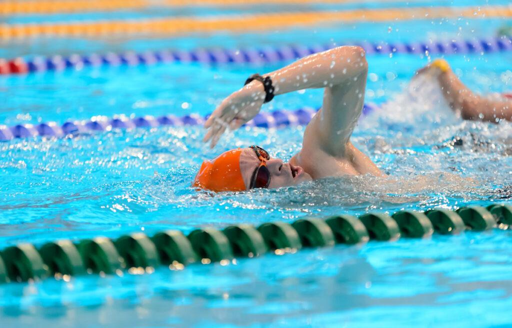 Male swimming in swimming pool